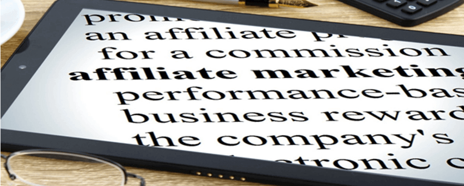 "A tablet lying on a table with the word ""Affiliate Marketing"" bold in the center of the screen."