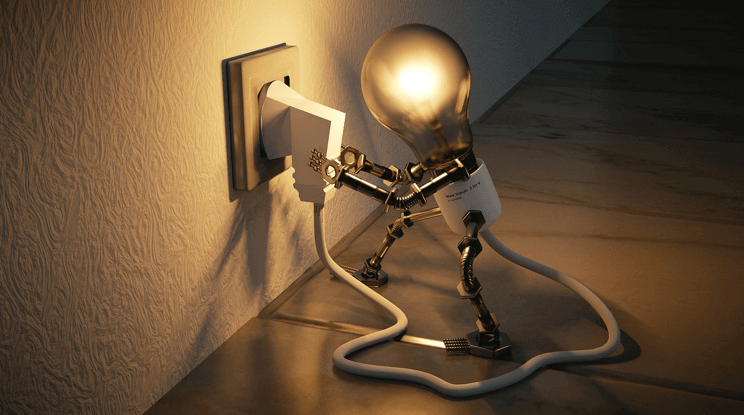 Image of a light-bulb plugging itself into a socket, representing the compatibility of great Magento extensions