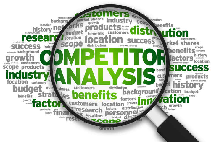 A Magnifying glass looking at terms regarding SEO Competitor Analysis