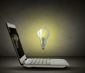 Image of a laptop computer with a lightbulb shining above it