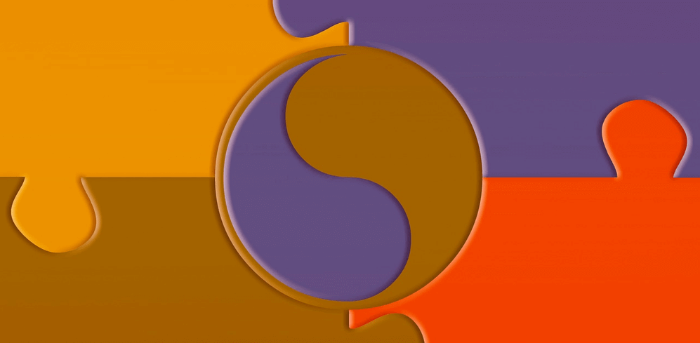Puzzle pieces connected around a yin-yang symbol