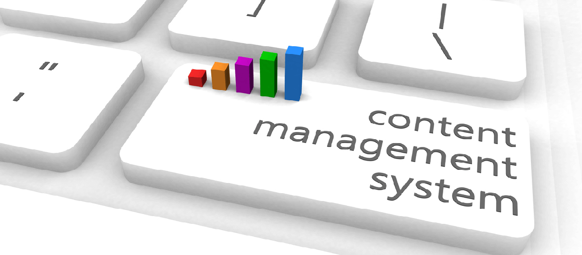 "Image of a keyboard with a key labeled ""content management system"""