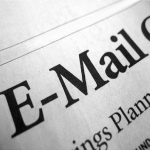"Image of part of a news headline that reads ""E-Mail""."
