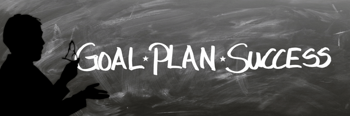 "Image of a blackboard with the words ""Goal"", ""Plan"", and ""Success"" written in chalk"