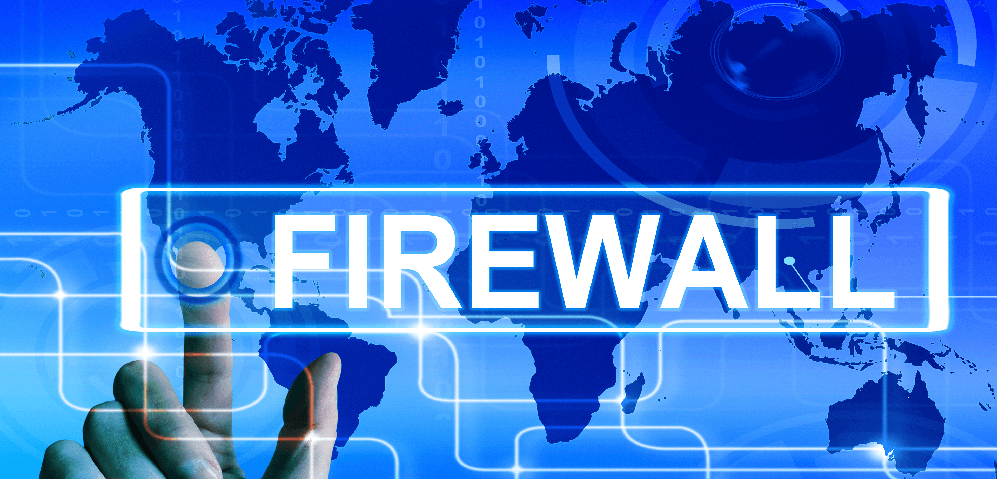 "Abstract image of the world's map behind a hand that touches the word ""FIrewall""."