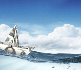 An image of a dollar folded into a ship and sailing in rough waters to depict the Ecommerce predictions and forecasts