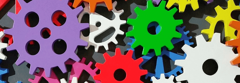 An image of colorful gears operating together