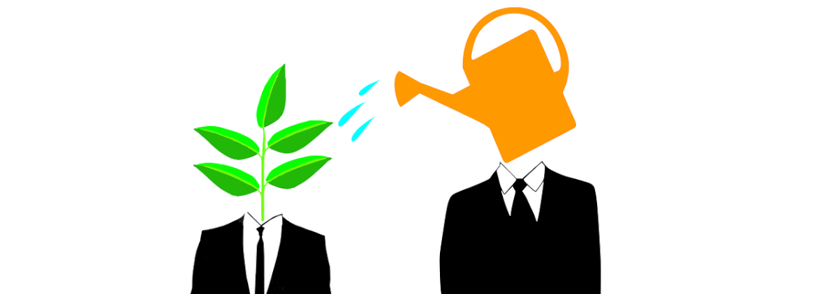 Image of two silhouettes, one with a watering can head that waters the other, who has a plant for a head