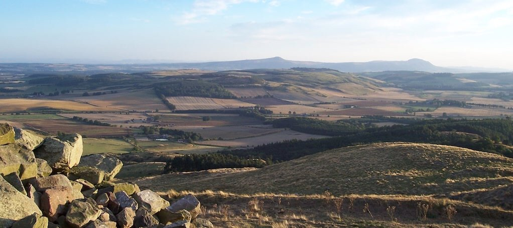 Looking across the farmland of North East Fife to the distant Lomond Hills. Credit: Creative Commons - How Routes Manager Helps Him Building a Hiker Community in Scotland