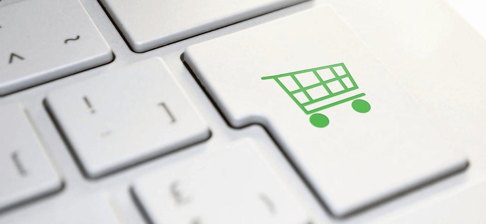 Image of a Shopping Cart shaped Key on a laptop keyboard