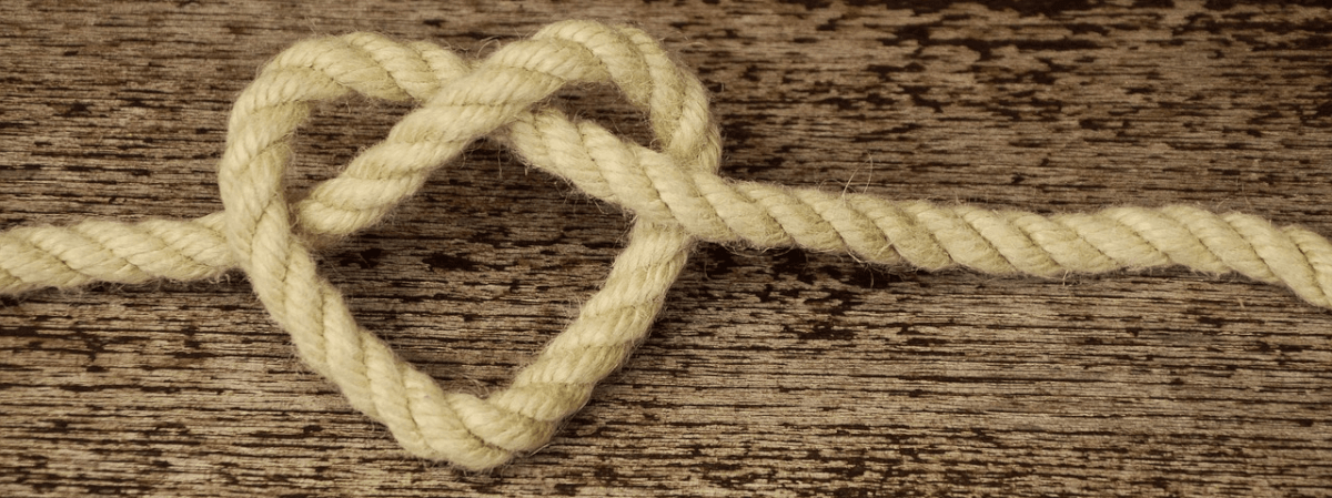 Image of a heart-shape formed by a length of rope to represent customer relations