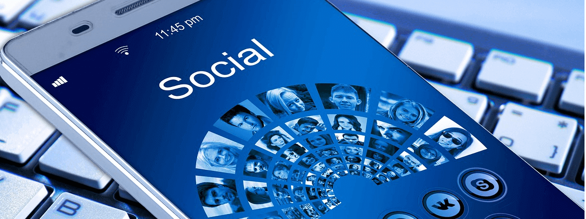 "Image of a phone with the word ""Social"" on the cover beside faces, representing the Ecommerce trend toward social media shopping"