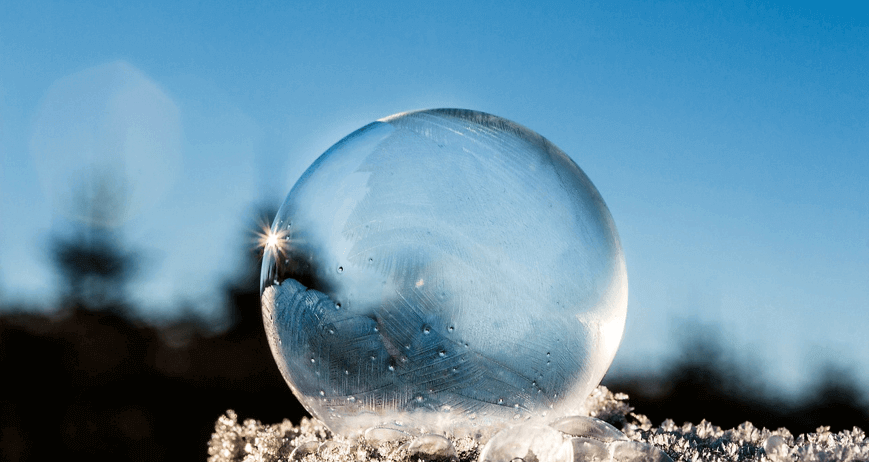 Image of a frozen bubble sitting transparently in the daylight