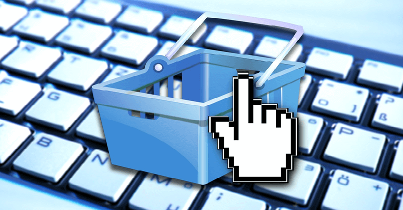 Image of a shopping cart on a keyboard, representing cross-selling on Ecommerce product pages