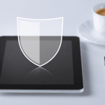 An Image of a tablet with a shield icon hovering above to portray Website Security.