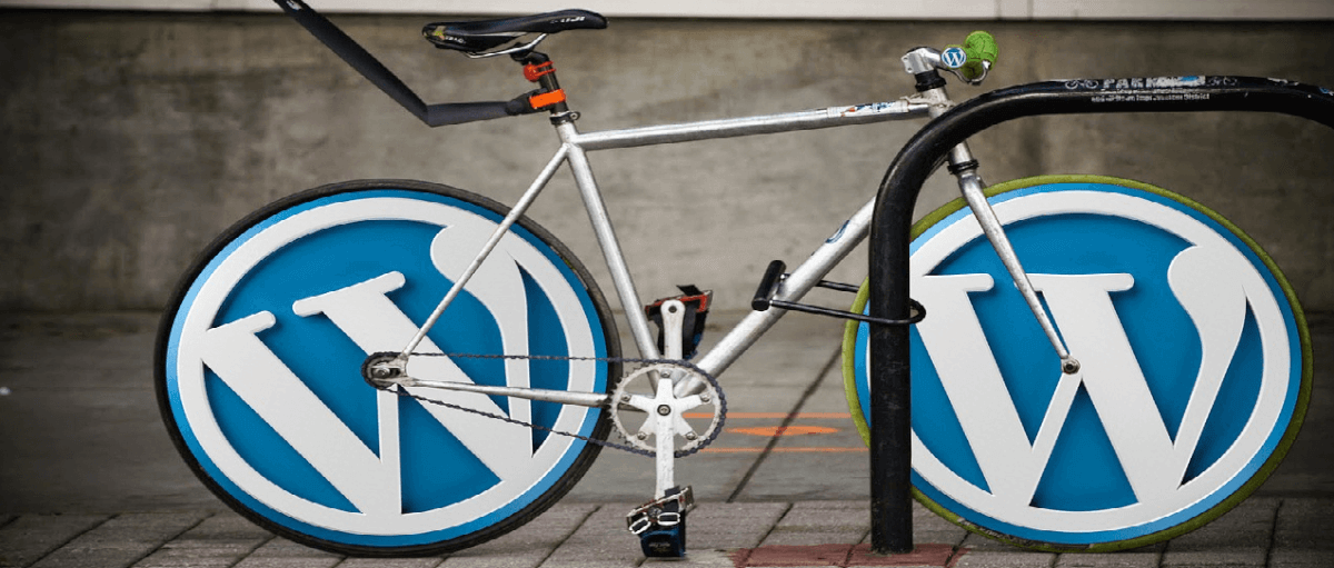 Image of a bicycle with WordPress site symbols on the wheels
