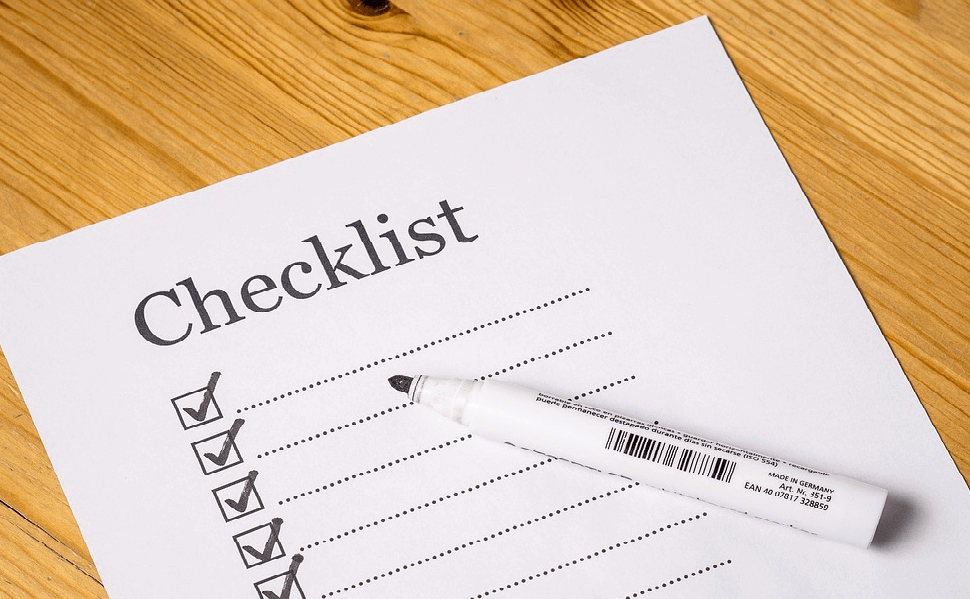 Picture of a paper checklist with every box marked, representing a checklist of tasks to complete after installing WordPress